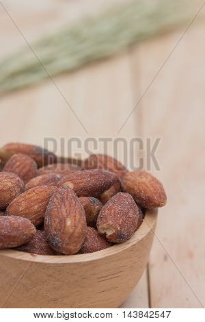 Almonds in cup on a wooden table