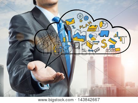 Close up of businessman hand showing cloud with business sketches