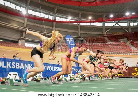 VIENNA, AUSTRIA - JANUARY 31, 2015:  Runners start in the women's 60m event during an indoor track and field event.