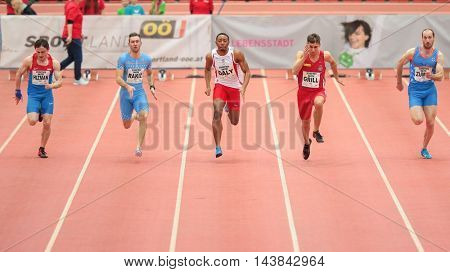 LINZ, AUSTRIA - FEBRUARY 6, 2015: Kiran Daly (#237 Great Britain) competes in the men's 60m event in an indoor track and field event.
