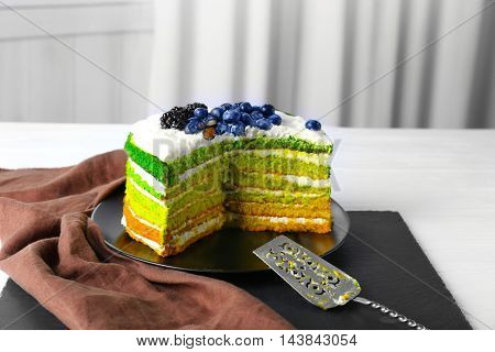 Delicious cake with berries on table