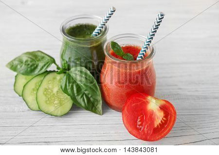 Tasty smoothie drinks with vegetables on table