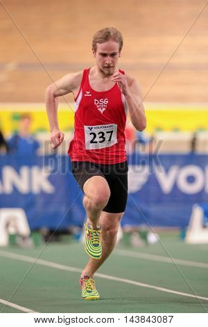 VIENNA, AUSTRIA - JANUARY 31, 2015: Lukas Kornfeld (#237 Austria) competes in the men's 60m event during an indoor track and field event.