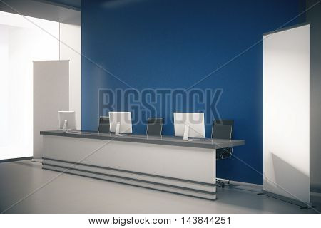 Side view of blue interior with blank posters empty wall and reception desk with computer monitors. Mock up 3D Rendering
