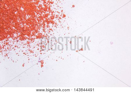 Eyeshadow Cosmetic Powder Scattered Copy Space. various set isolated on white background. The concept of fashion and beauty industry. Abstract place text the texture mineral makeup. bright orange color