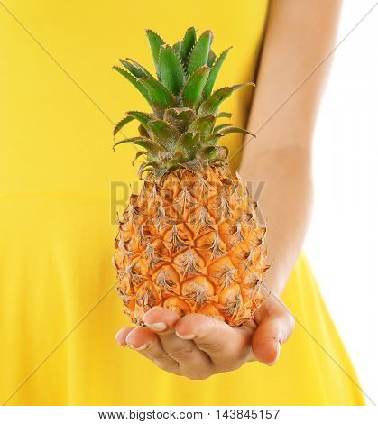 Woman holding pineapple, closeup