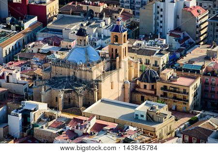 Co-cathedral Saint Nicolas in Alicante hidden between the houses, summer Spain