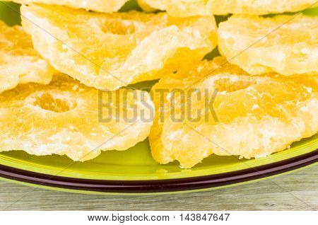 Dried Pineapple Rings In Green Plate