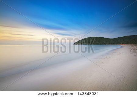 Sunset Cala Violina bay beach in Maremma Tuscany. Travel destination in Mediterranean sea. Italy Europe. Long Exposure.