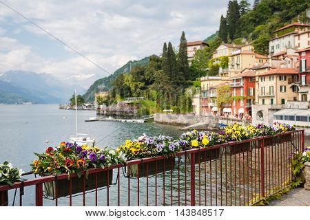 Cityscape of Varenna at Lake Como focus on flowers