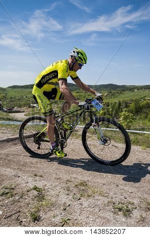 KHVALYNSK - MAY 7, 2016: Male cyclist rides fast at XCE eliminator track championship 'Match of Russian cities' on May 7, 2016 in Khvalynsk, Saratov region, Russia.