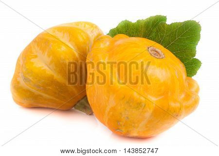 two yellow pattypan squash with leaf isolated on white background.