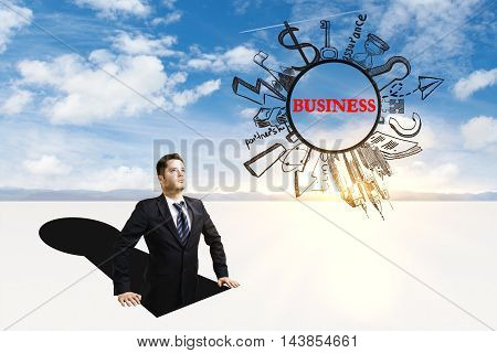 Businessman inside abstract keyhole looking at business sketch on sky background