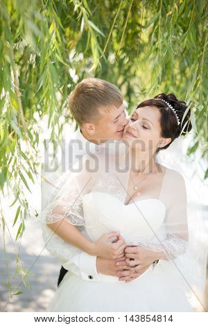 Loving Couple Hugging On Wedding Day