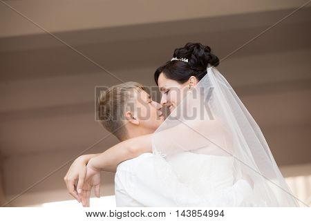 Happy Newlyweds Dancing And Hugging