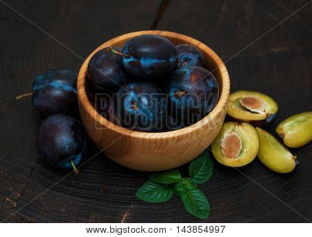 Bowl With  Plums With Green Leaves