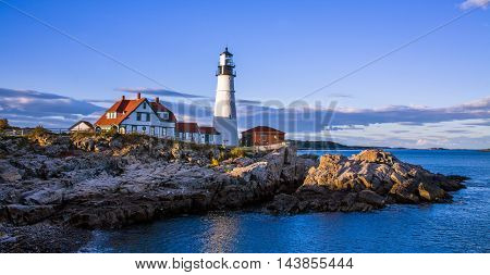 A classic New England Lighthouse in late afternoon The Portland Head Light at Portland Maine USA
