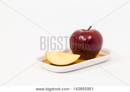 Red Apple And Red Apple Slice On White Plate With Honey Isolated On A White Background