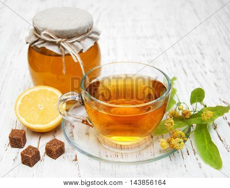 Cup Of Herbal Tea With Linden Flowers