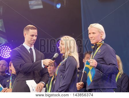 STOCKHOLM SWEDEN - AUG 21 2016: Swedish female wrestler Jenny Fransson and Sofia Mattson getting interviewed when swedish olympic athletes are celebrated in Kungstradgarden