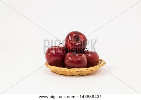 Ripe Red Apples In Wicker Basket Isolated On White Background