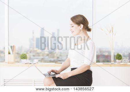 Cheerful Businesswoman Using Laptop Side