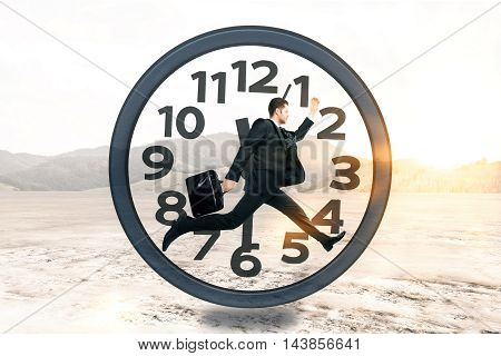 Businessman with briefcase running inside clock on landscape background with sunlight. Time management concept