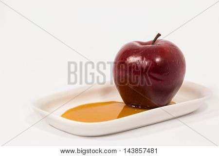 Red Apple On White Plate With Honey Isolated On A White Background