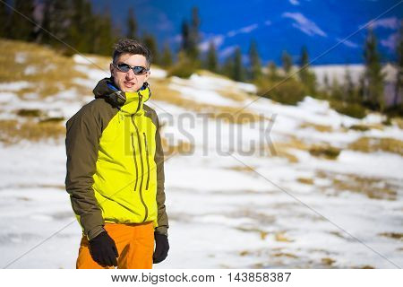 Portrait Of Mountaineer With Mountains In The Background.