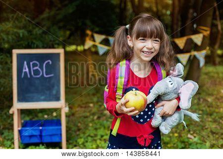 happy beautiful girl schoolgirl. Back to school concept.