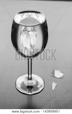 Elegant wine glass with water reflects sunlight glass shards