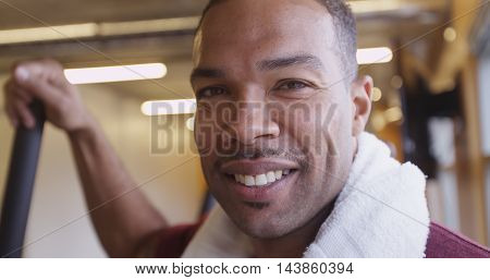 Close up portrait of happy smiling fit black man in gym after working out
