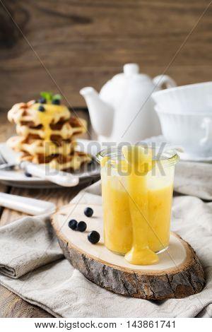 Lemon Kurd in a glass jar. Rustic style. Selective focus.