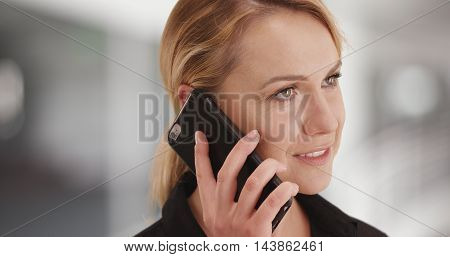 Businesswoman talking on smartphone in the office