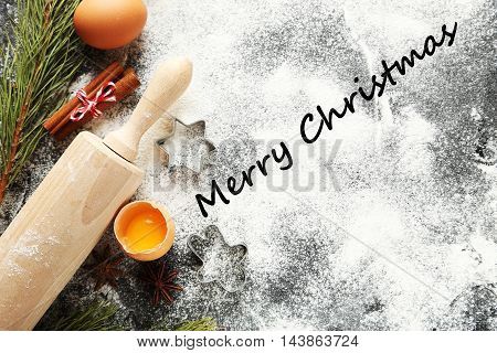 Christmas tree branch with cinnamon eggs flour and anise star on wooden table, merry christmas