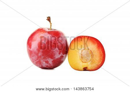 Fresh plum isolated on a white, close up