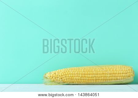 Ripe And Tasty Corn On Blue Wooden Table