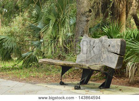 Unique park bench along a walk in a park.