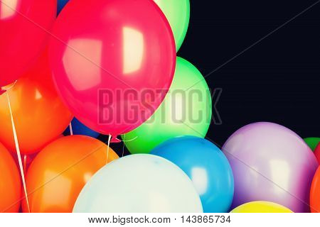 Group Of Glossy Colorful Balloons Over Black