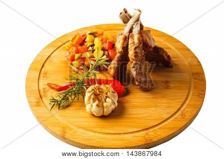 Rack of lamb with tkemali sauce and vegetable Ratatouille. Selective focus. Isolated on white.