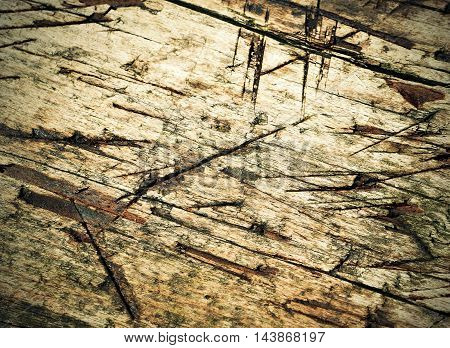 background or texture Old wood plank of carve notches