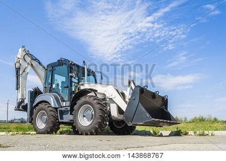 The New Tractor Is On The Road In The City