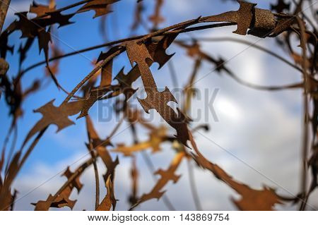 stabbing sharp fence on blurred sky background
