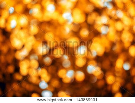 Holiday blurred bokeh golden color. Abstract Christmas background.