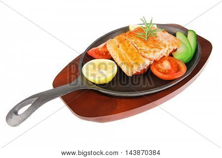 healthy lunch : sea roast salmon on metal pan over red wooden plate with vegetables isolated over white background