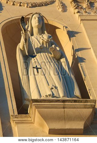Statue of the Virgin Mary holding a Rosary at the Sanctuary of Fatima in Portugal.