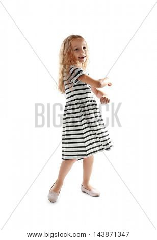 Cheerful little girl dancing on white background