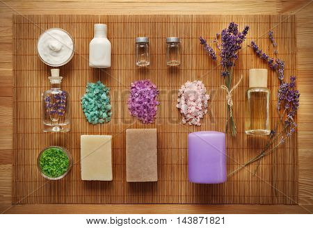 Spa composition with lavender and salt on straw mat background