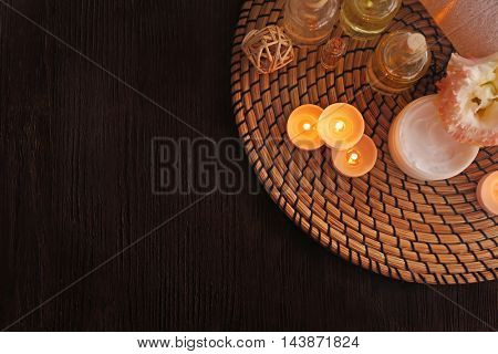 Beautiful spa composition with flowers on wooden background