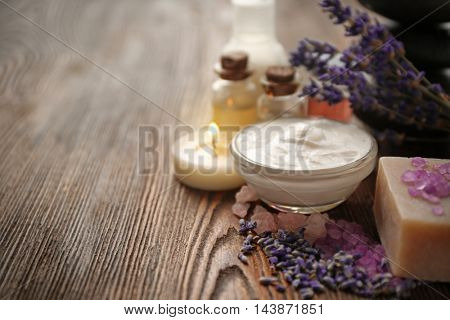 Spa composition with lavender and cream on wooden background